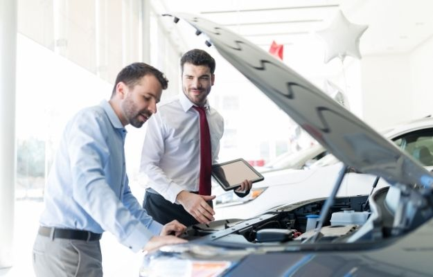 2 man looking at the car engine - How Discovery Search Works in Local Car Dealer Marketing | | How Discovery Search Work in Local Car Dealer Marketing | Auto Industry Update: Discovery Searches Turn One-Time Visitors into Lifetime Customers
