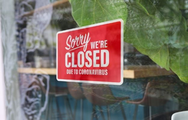 a red closed sign in front of a restaurant   Restaurant Operations During Covid19: An Update   How Food Businesses Stay Up To Date During Covid-19