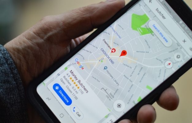 Guy holding his phone with google map open - More Than Just a Local Listing | How to Add a Black-Owned Business Attribute to Your Google Maps