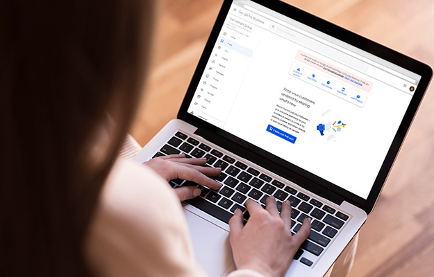 woman posting on my google business on her laptop   Post Regularly on Your Listing Page   5 Ways to Rank Higher on Google Maps in 2021