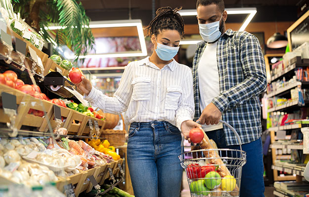 African couple doing shopping at a local grocery store | How To Get More Foot Traffic To Your Business