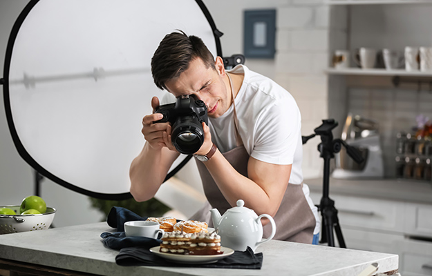 A cafe owner taking picture of the dessert | How Photos Can Increase Your Google My Business Listing Performance