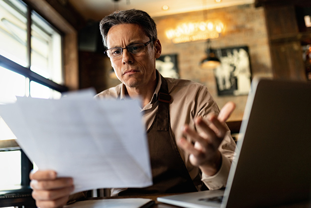 Cafe Owner is reading policy and reviews    Why Google My Business Is Not Working For You